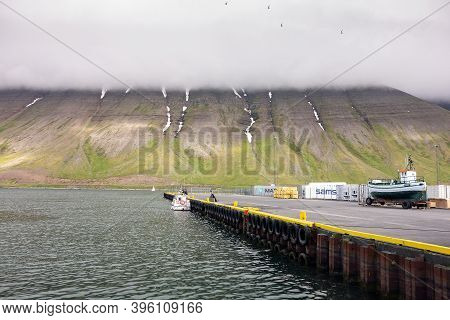 Isafjordur, Iceland - July 7, 2014: The Harbour And Pier Of The Isafjordur City In Iceland With Sams