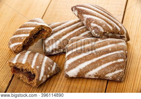 Broken Gingerbread With Jam, Whole Striped Gingerbreads On Wooden Table