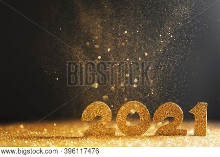 2021 New Year luxury design concept. Golden 2021 New Year horizontal template with golden glitter on blue backgound