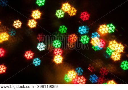 New Year festive background. Blurred New year background, festive New year multicolor bokeh background in form of the snowflakes, New year festive card, New year colorful wallpaper