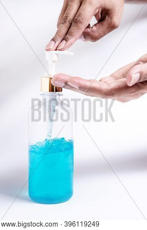 Hand Human With Alcohol Gel On White Background, Corona Virus Or Covid-19 Concept