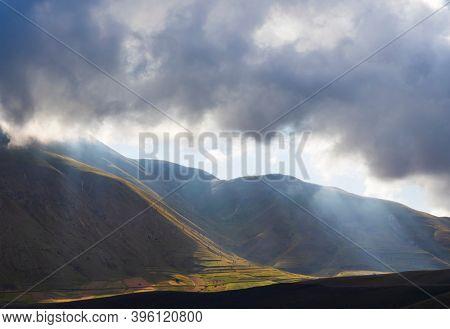 Dramatic mountain landscape near Castelluccio village in National Park Monte Sibillini, Umbria region, Italy