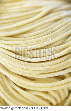 Close Up Of Raw Uncooked Chinese Yellow Egg Noodle Food Background