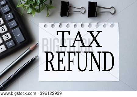 Tax Refund. Text On White Paper On A Gray Background