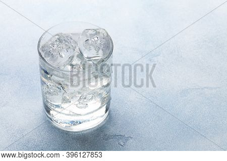 Glass of water with ice cubes. With copy space