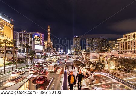 Las Vegas,  Usa - March 3, 2019: Cars By Night At The Strip In Las Vegas And Casinos   At Night With