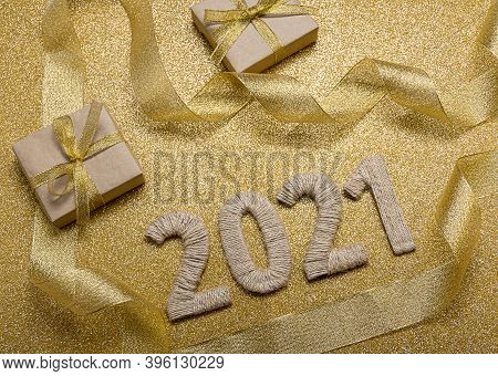 Happy New Year. Craft Gifts And Handcrafted Lettering 2021 On Gold Background. Top View