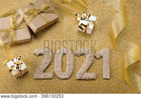 Top View. Bright Golden New Year Card With Gifts And Lettering 2021, Christmas Tinsel