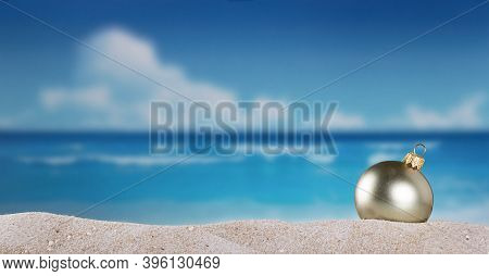 Christmas Ball In The Sand On The Beach On A Bright Sunny Day Of New Years Eve