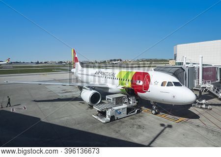 Lisbon, Portugal - March 9, 2020:  Tap Aircraft At The Gate Ready For Boarding At Lisbon Airport Hum