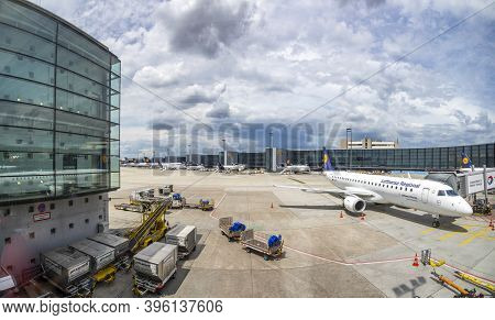 Frankfurt, Germany - June 8, 2020: Lufthansa Aircrafts Stay At The Boarding Finger At The Airport In