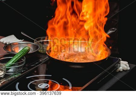 The Chef Cooks The Shrimp On A Metal Frying Pan