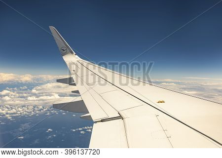 Frankfurt, Germany - June 8, 2020: Lufthansa Aircraft In The Sky Over The Clouds At The Corona Trave