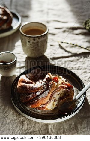 Cinnamon Swirl Brioche Or Cinnamon Roll Bun And Cups Of Cocoa On Greige Linen Tablecloth. Homemade B
