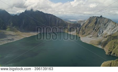 Crater Lake Of The Volcano Pinatubo Among The Mountains, Philippines, Luzon. Aerial View Beautiful L