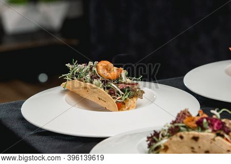Table With Ready To Eat Shrimp Tacos With Coleslaw And Salsa
