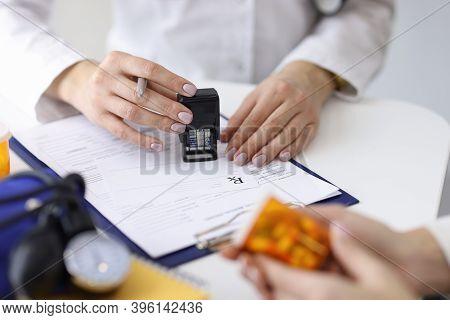 Doctor Writes Prescription For Pills To Patient. Prescription Drugs Concept