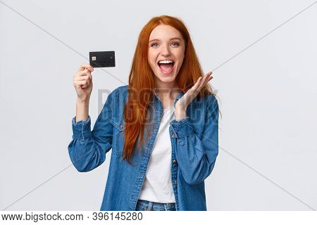 Charismatic Happy Good-looking Redhead Female Student In Casual Clothes, Holding Credit Card With Be