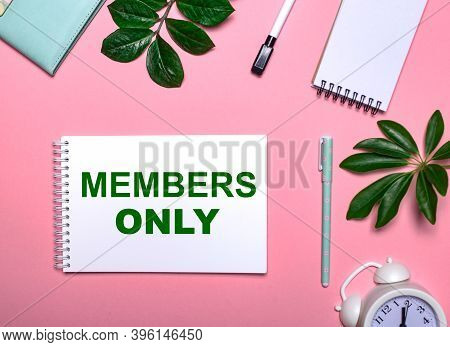 Members Only Is Written In Green On A White Notepad On A Pink Background Surrounded By Notepads, Pen