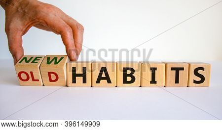 Time To New Habits. Hand Turns Cubes And Changes The Words 'old Habits' To 'new Habits'. Beautiful W