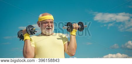 Freedom Retirement Concept. Senior Man In His Seventies Training And Lifting Weigh. Portrait Of Heal