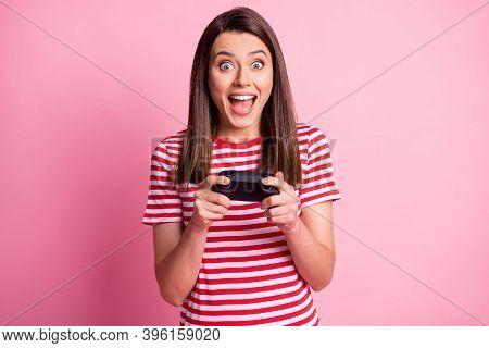 Photo Portrait Of Cheerful Girl Playing Video Game Keeping Console Controller Staring Isolated On Pa