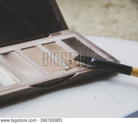 Palette Of Brown Shades For Makeup With A Brush. Brow Makeup At Home. Close Up Picture Of Cosmetics.