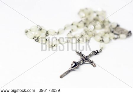White Pearl Rosary With Silver Crucifix Isolated On A White Background. Prayer And Devotion. Religio