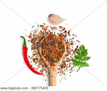 Vegetable Seasoning In A Wooden Spoon With Garlic Pepper And Greens