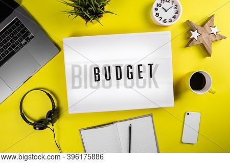 Budget Word Text On Lightbox On Modern Yellow Office Desktop. Public Expenditures, National Budget A