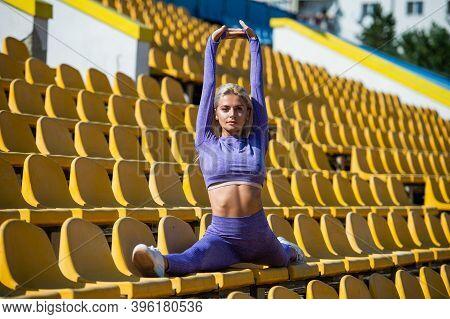 Sexy Fitness Woman Stretching In Sportswear Sit In Split On Stadium, Split