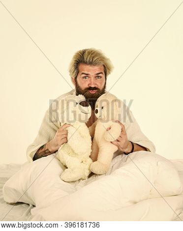 Cute Teddy Bear Toy. Positive Bedroom Environment. Playful And Romantic. Man Hug Toy Relaxing In Bed