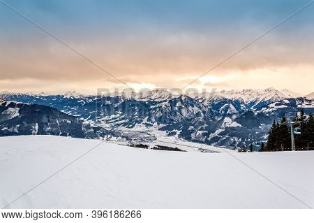 Zell Am See At Zeller Lake In Winter. View From Schmittenhohe Mountain, Snowy Slope Of Ski Resort In