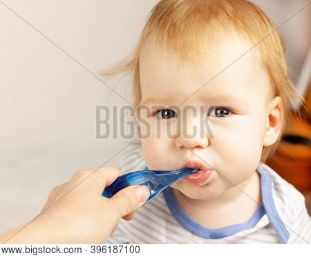 Mom Brushes Her Baby's Teeth. Oral Cavity Care. First Teeth. Teething. Baby Care.