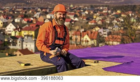 Professional Master Repair Roof. Flat Roof Installation. Roofing Felt. Roofer Worker In Protective W