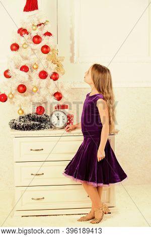 Winter Holiday Concept. Family Holiday Concept. Girl Velvet Dress Feel Festive Near Christmas Tree.