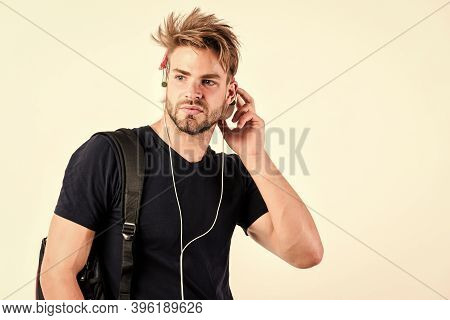Student Handsome Guy Listening Music. Rhythmic Melody Concept. Enjoy Music Everywhere You Go. Youth