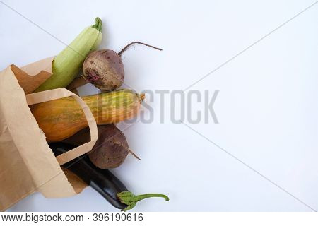 Healthy Food Delivery Background. Vegetarian Food In Paper Bag Vegetables Isolated On White, Copy Sp