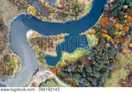 River With Colorful Autumn Riversides Top Down View. Abstract Autumn Background.