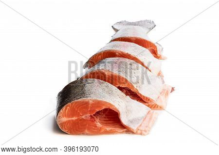 Fresh  Raw Headless Rainbow Trout Fish Cut Into Pieces Isolated On White
