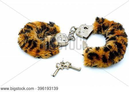 White Background, Isolate. Fluffy Bondage With Leopard Color For Sexual Game. Toy For Making Sex In