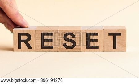 Woman Made Word Reset With Wood Blocks