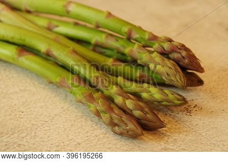 Asparagus. Bunches Of Green Asparagus On A Yellow Background. Top View Image. Fresh Asparagus.