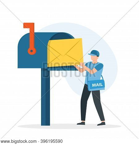 Man Postman With Bag On Shoulder Put Letter In Mail Box.