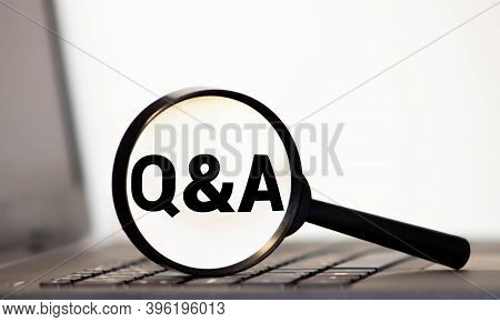 Q And A Written On White Paper On Office Table With Charts Diagrams Contract And Financial Documents
