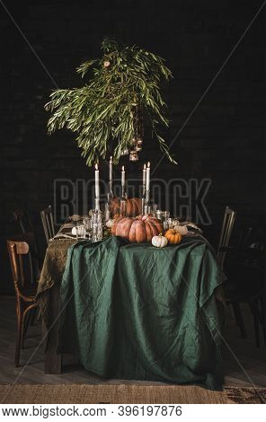 Stylish Rustic Thanksgiving Day Party Table Setting. Solid Table With Green Linen Tablecloth, Dinner