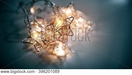 Christmas Luminous Garland In The Shape Of Stars From Led Bulbs. Glowing Stars Made Of Wire. Yellow-