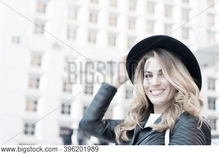 Woman Smile With Sensual Face, Long Hair, Black Hat In La Defense Paris. Fashion, Beauty, Look. Vaca