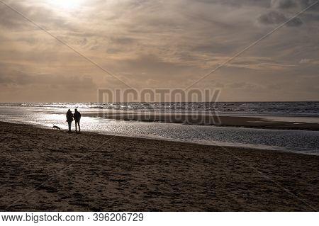 Winter Walking On Wide Sandy Beach Of North Sea Near Zandvoort In Netherlands