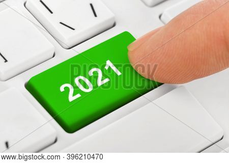 Computer notebook keyboard with 2021 key - holiday technology concept